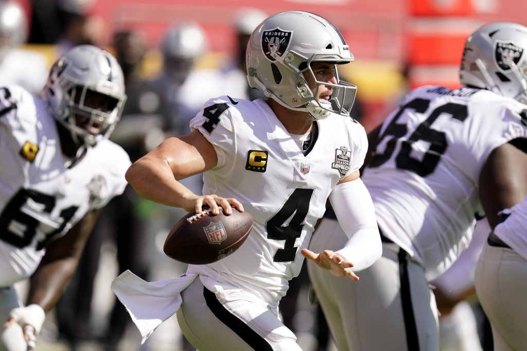 Las Vegas Raiders quarterback Derek Carr (4) looks to throw a pass during the first half of an NFL football game against the Kansas City Chiefs, Sunda...