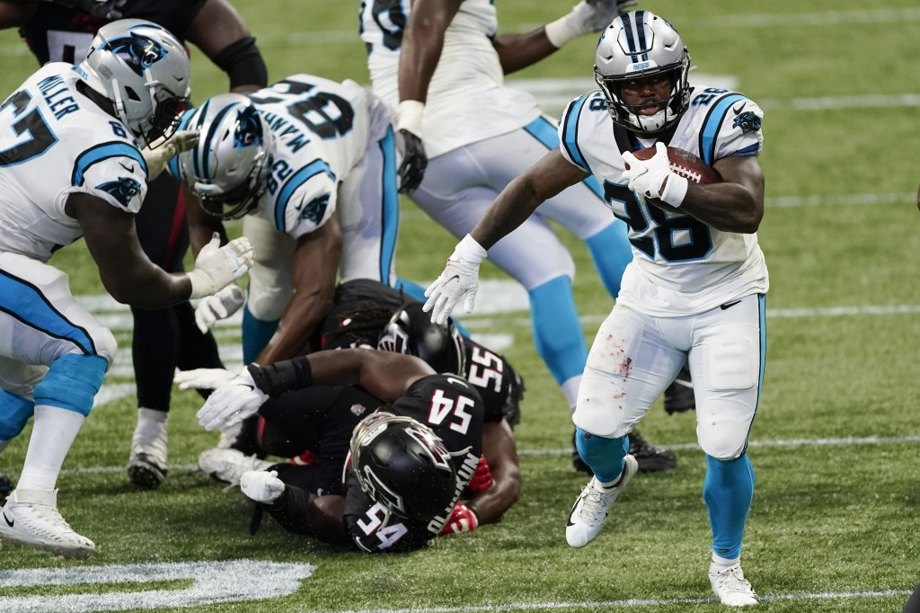 Carolina Panthers running back Mike Davis (28) runs against the Atlanta Falcons during the second half of an NFL football game, Sunday, Oct. 11, 2020,...