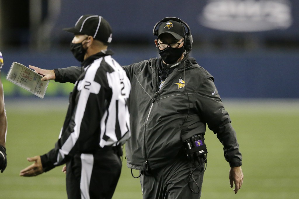 Minnesota Vikings head coach Mike Zimmer talks with an official during the second half of an NFL football game against the Seattle Seahawks, Sunday, O...