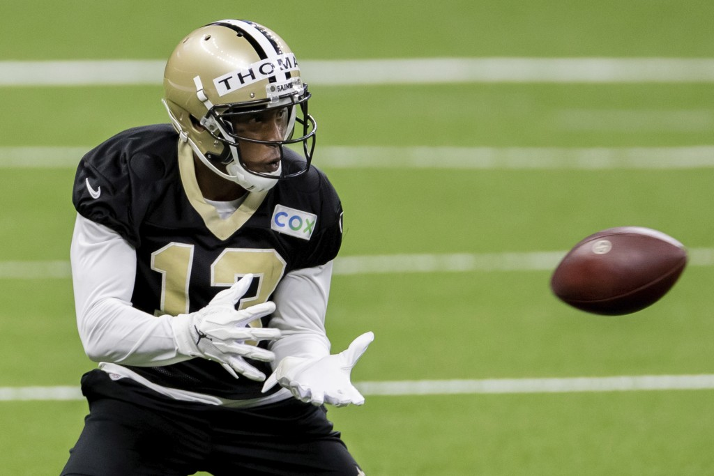 FILE - In this Saturday, Aug. 29, 2020, file photo, New Orleans Saints wide receiver Michael Thomas catches the ball during NFL football training camp...
