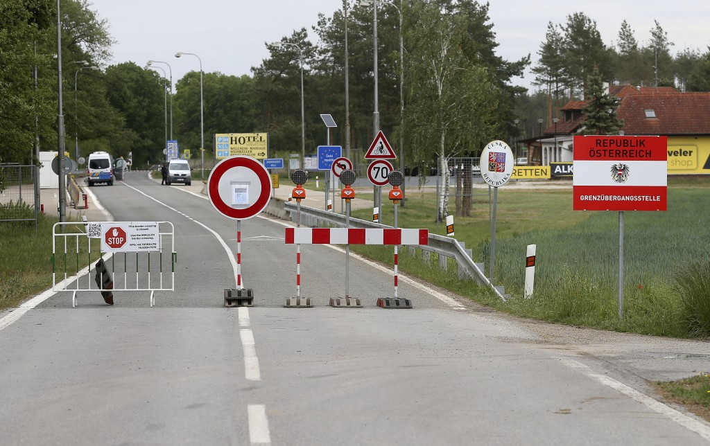 FILE - In this May 13, 2020 file photo, a barrier blocks the road at the closed border crossing from Austria to the Czech Republic near Reinthal, Aust...