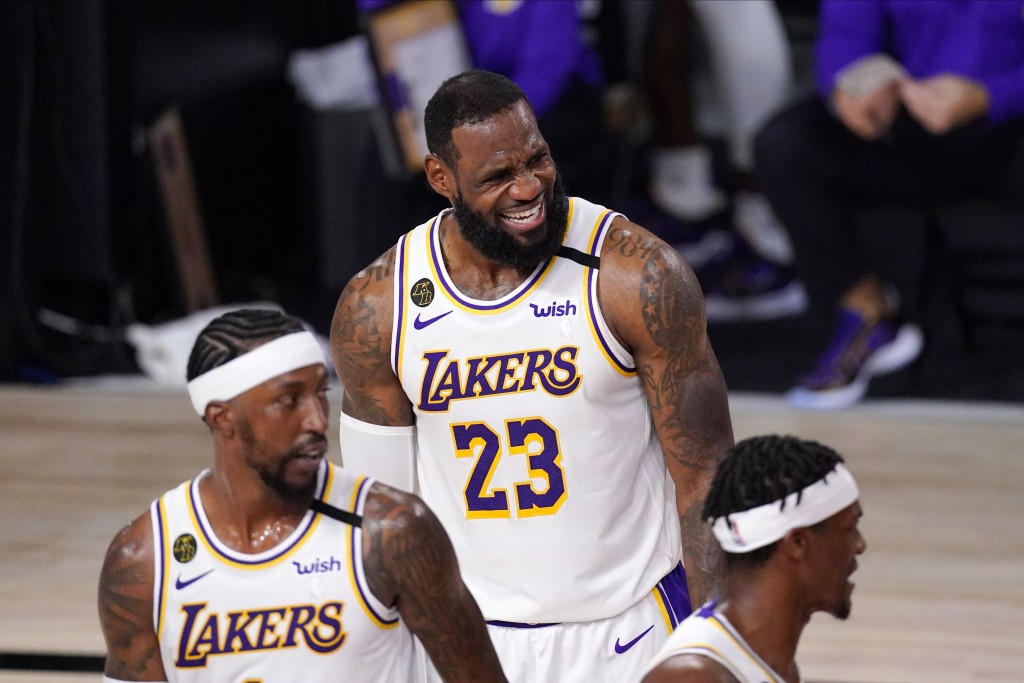 Los Angeles Lakers' LeBron James (23) reacts during the first half in Game 6 of basketball's NBA Finals against the Miami Heat Sunday, Oct. 11, 2020, ...