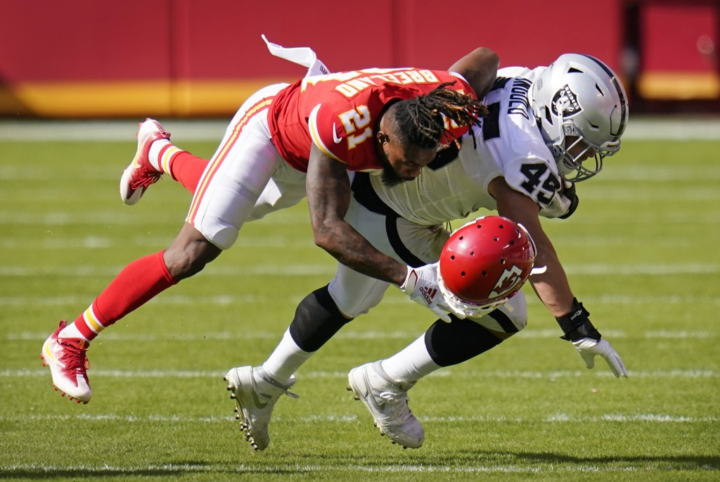 Kansas City Chiefs cornerback Bashaud Breeland (21) loses his helmet as he tackles Las Vegas Raiders fullback Alec Ingold (45) during the second half ...