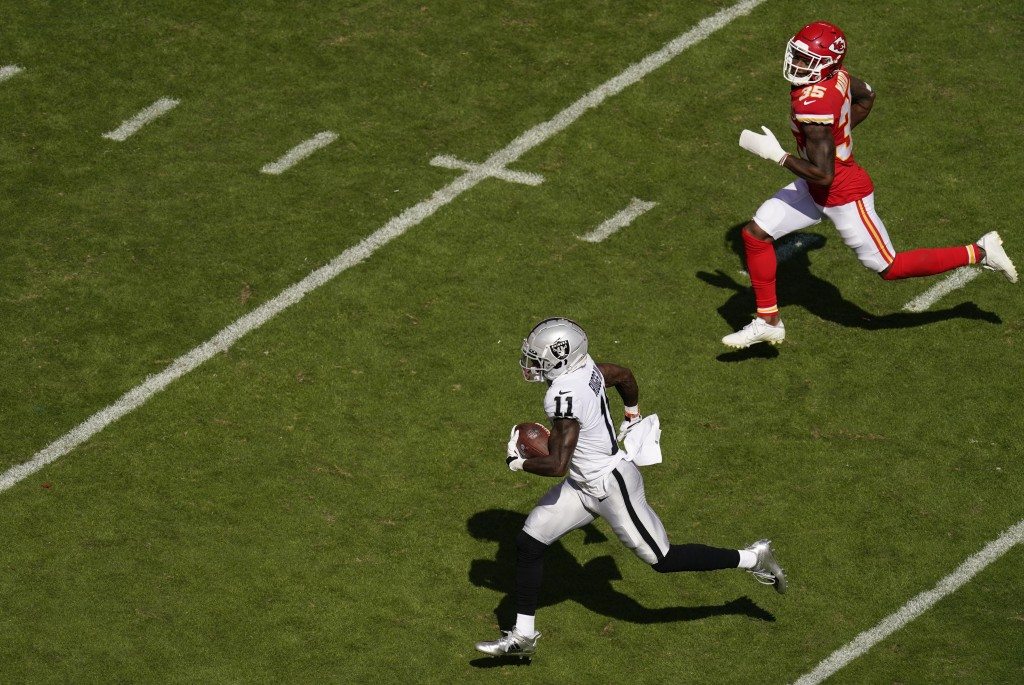 Las Vegas Raiders wide receiver Henry Ruggs III (11) runs from Kansas City Chiefs cornerback Charvarius Ward (35) during a 72-yard touchdown reception...