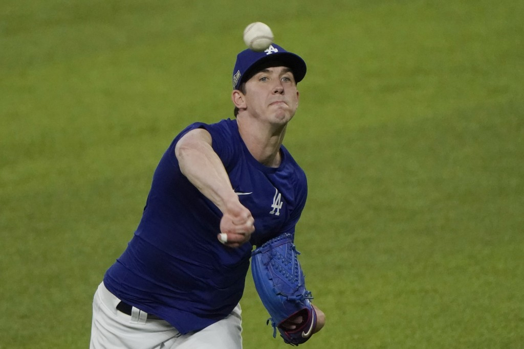 Los Angeles Dodgers' Walker Buehler, scheduled to pitch during Game 1 of the National League Championship Series against the Atlanta Braves, has tape ...