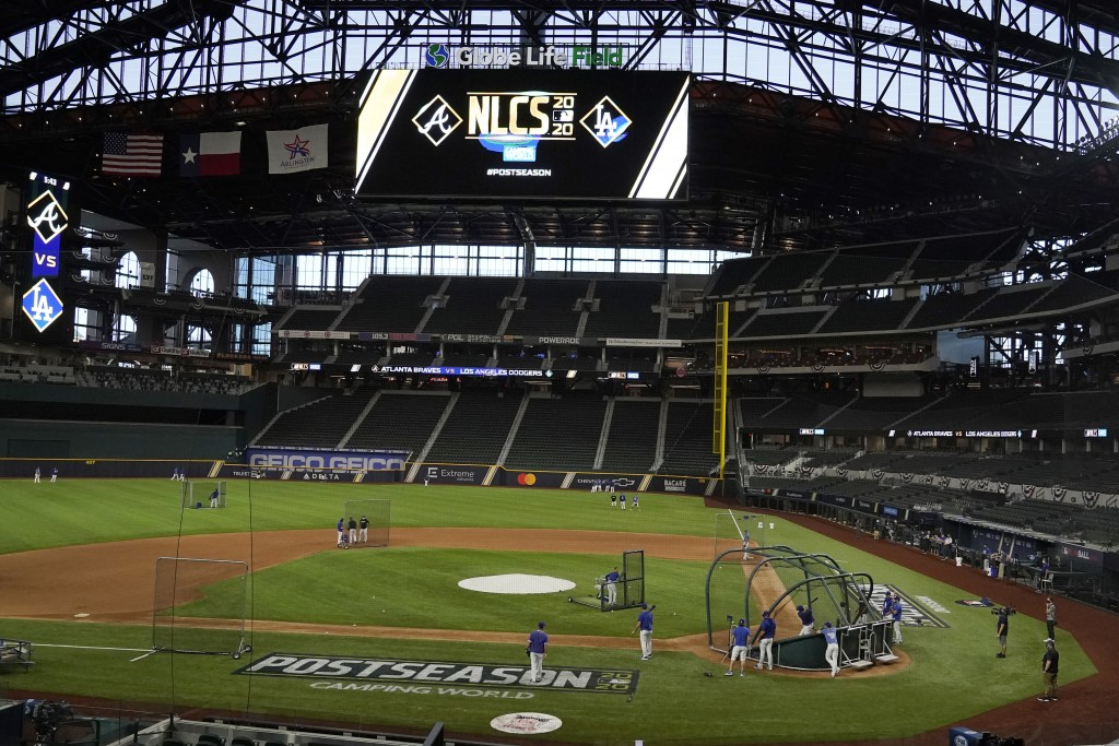 The Los Angeles Dodgers work out in Globe Life Field before the National League Championship Series against the Atlanta Braves in Arlington, Texas, Su...