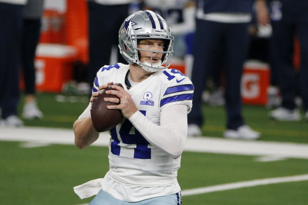 Dallas Cowboys quarterback Andy Dalton (14) drops back to pass in the second half of an NFL football game against the New York Giants in Arlington, Te...