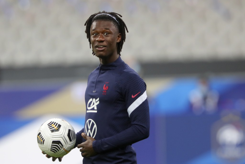 France's Eduardo Camavinga holds a ball during warmup before the UEFA Nations League soccer match between France and Portugal at the Stade de France i...