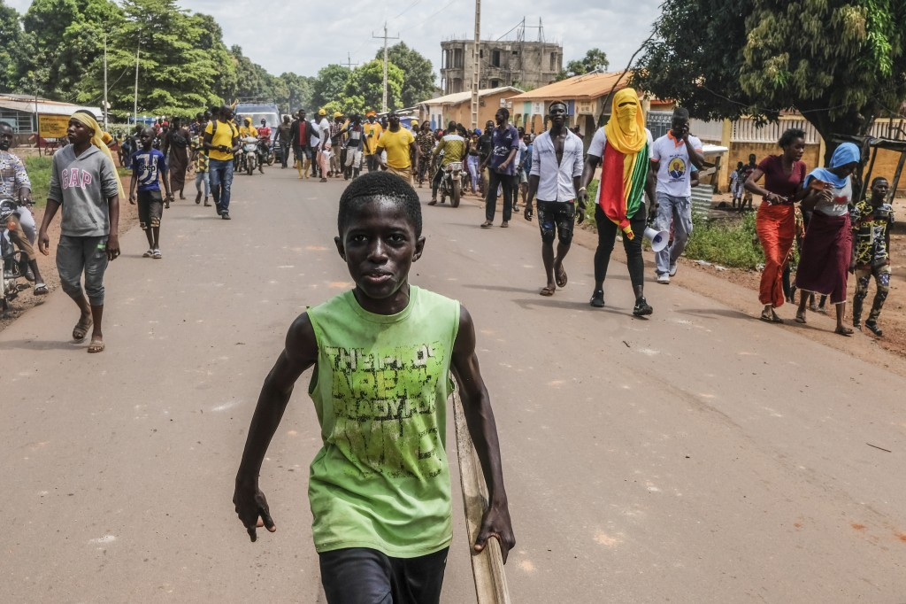 Supporters of the ruling Rally of the Guinean People (RPG) party demonstrate against the opposition Union of Democratic Forces of Guinea (UFDG) party ...