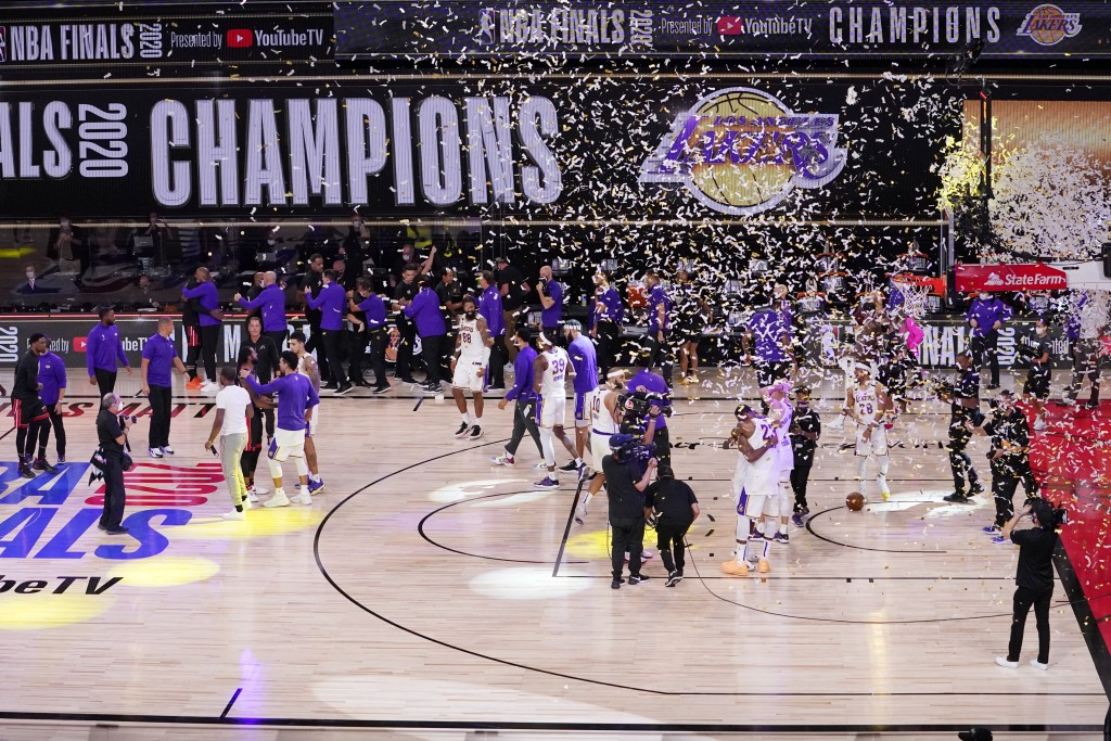 The Los Angeles Lakers players celebrate after the Lakers defeated the Miami Heat 106-93 in Game 6 of basketball's NBA Finals Sunday, Oct. 11, 2020, i...