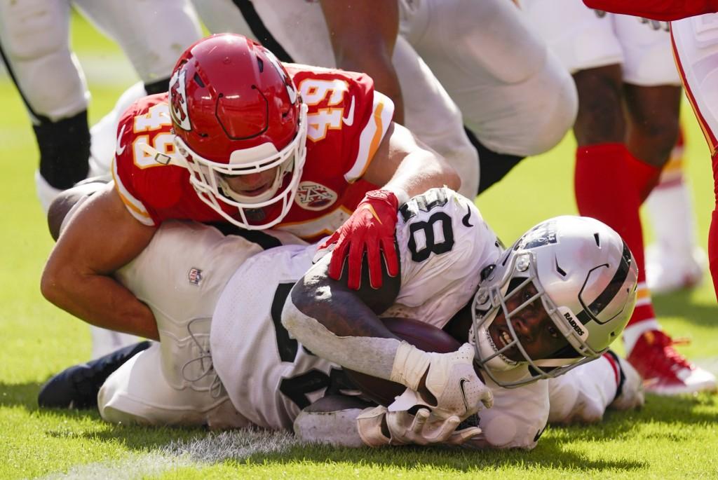 Las Vegas Raiders running back Josh Jacobs scores on a 7-yard touchdown run ahead of Kansas City Chiefs safety Daniel Sorensen (49) during the second ...