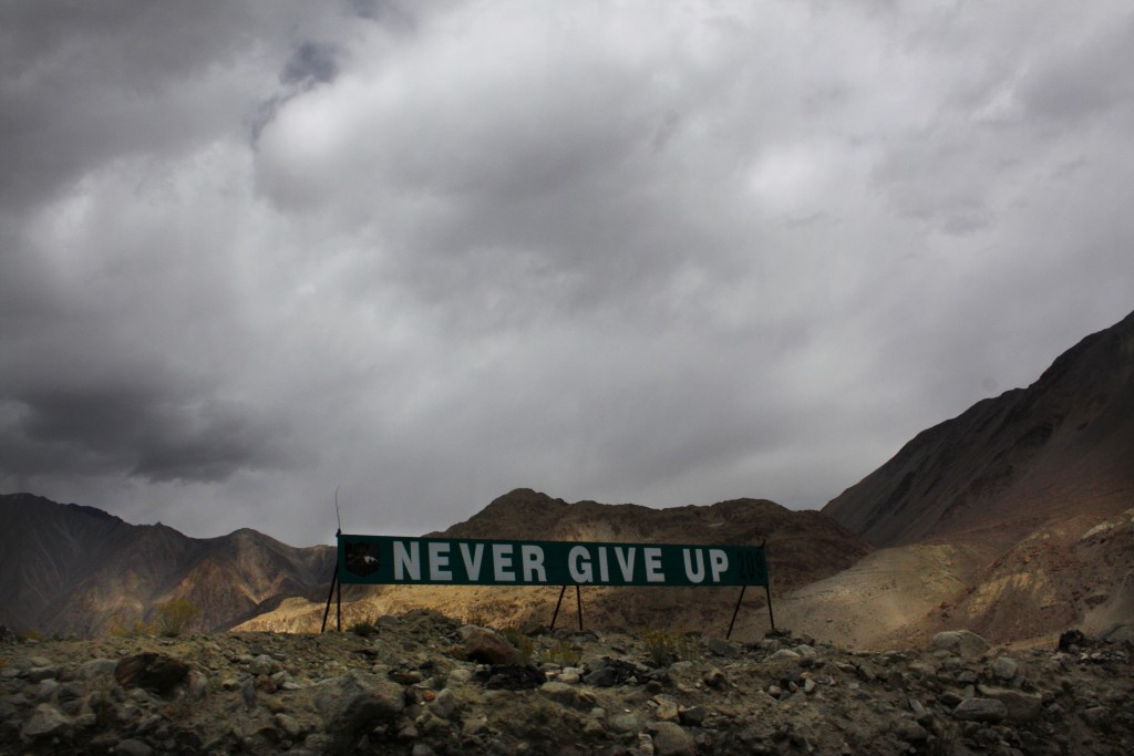 In this Sept. 14, 2017, file photo, a banner erected by the Indian army stands near Pangong Tso lake near the India-China border in India's Ladakh are...