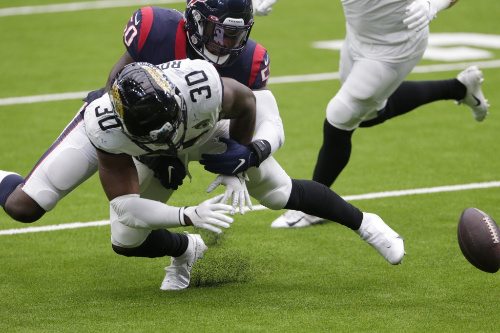 Jacksonville Jaguars running back James Robinson (30) fumbles as he is hit by Houston Texans linebacker Tyrell Adams (50) during the second half of an...