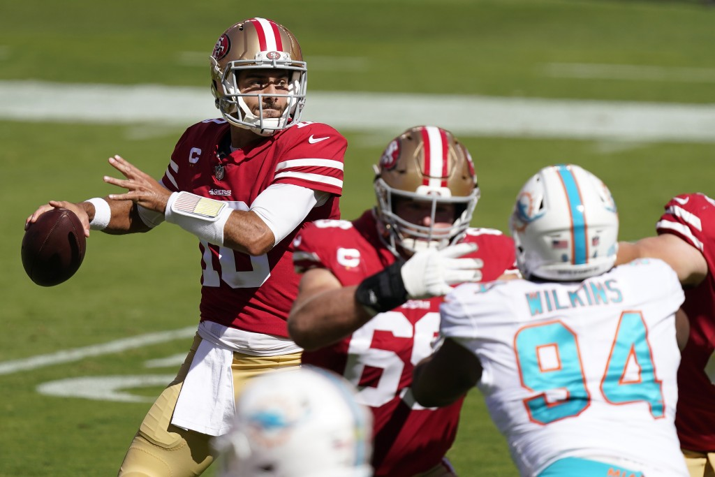 San Francisco 49ers quarterback Jimmy Garoppolo (10) passes against the Miami Dolphins during the first half of an NFL football game in Santa Clara, C...