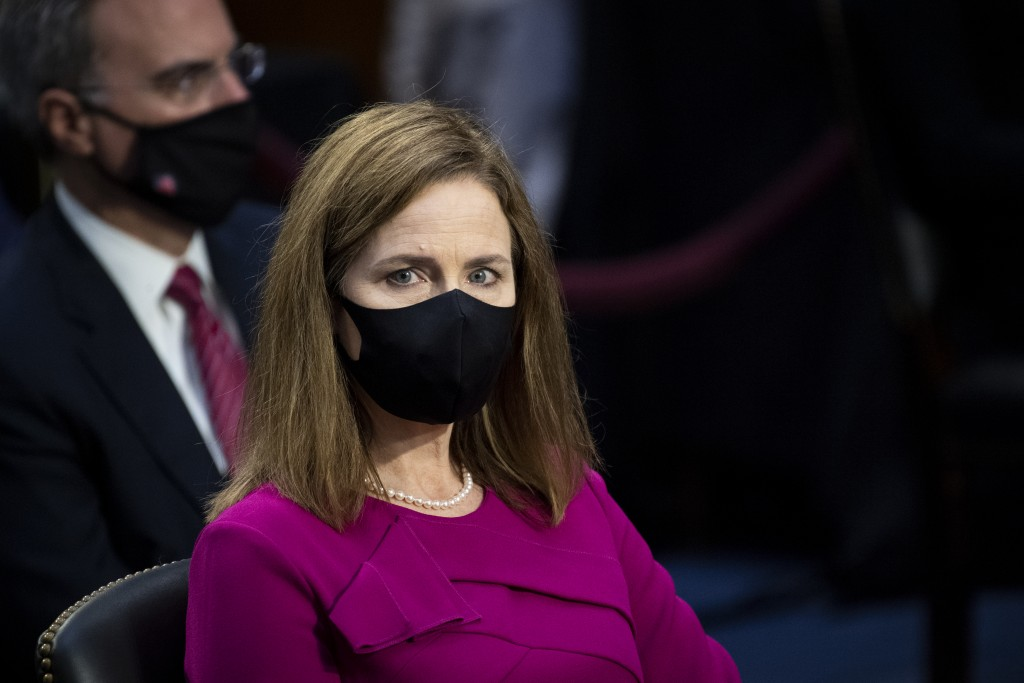 Supreme Court nominee Amy Coney Barrett listens during her Senate Judiciary Committee confirmation hearing on Capitol Hill in Washington, Monday, Oct....