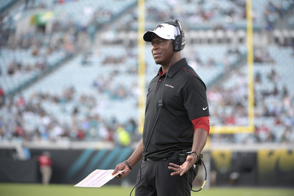 FILE - In this Aug. 19, 2019, file photo, Atlanta Falcons then-assistant head coach/passing game coordinator Raheem Morris watches from the sideline d...