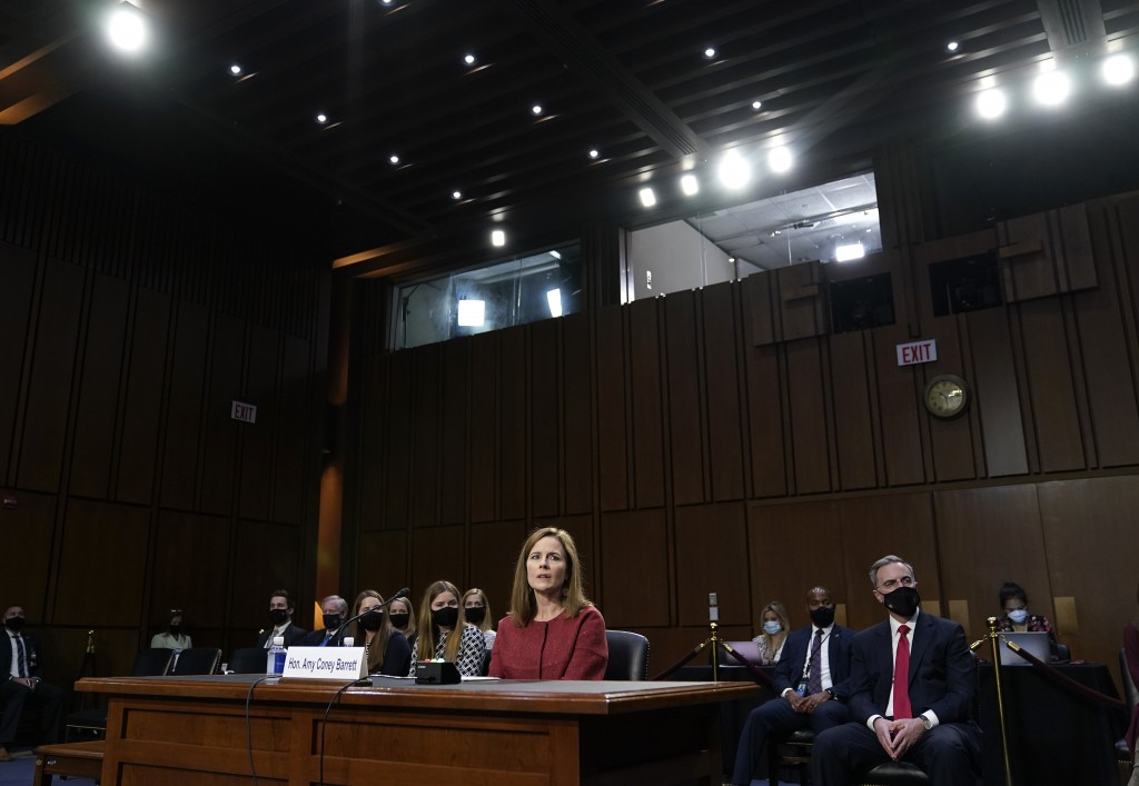 Supreme Court nominee Amy Coney Barrett listens during the second day of her confirmation hearing before the Senate Judiciary Committee on Capitol Hil...