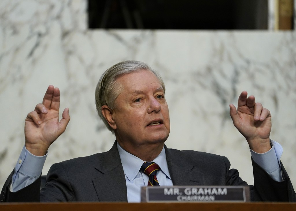 Senate Judiciary Committee Chairman Lindsey Graham, R-S.C., questions Supreme Court nominee Amy Coney Barrett during the second day of her confirmatio...