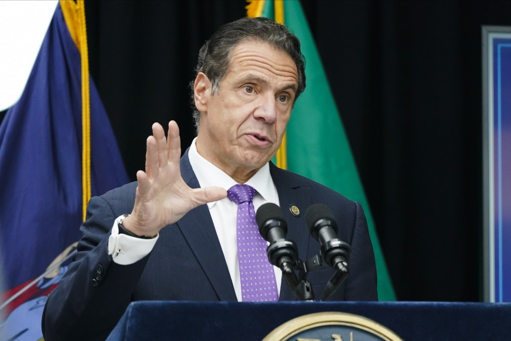 New York Gov. Andrew Cuomo speaks during a ceremony to unveil the statue of the patron saint of immigrants, Mother Frances Cabrini, in Battery Park Mo...