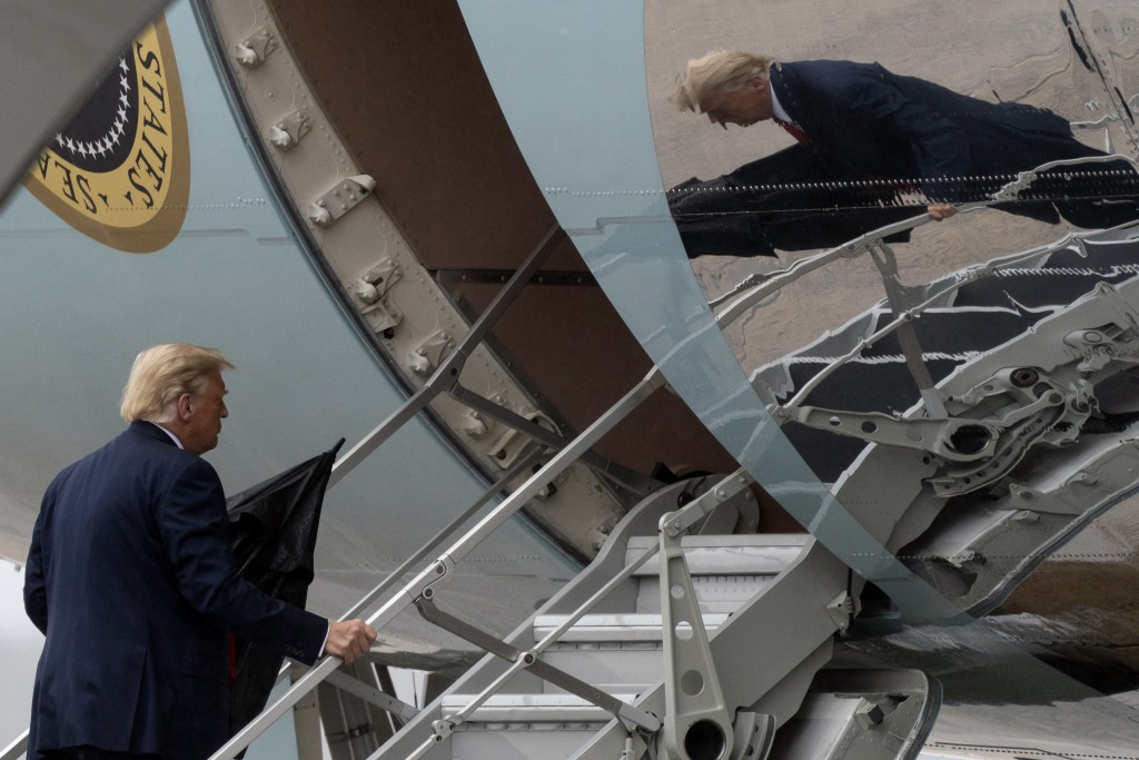 President Donald Trump boards Air Force One, Monday, Oct. 12, 2020, at Andrews Air Force Base, Md. Trump is en route to Florida. (AP Photo/Alex Brando...