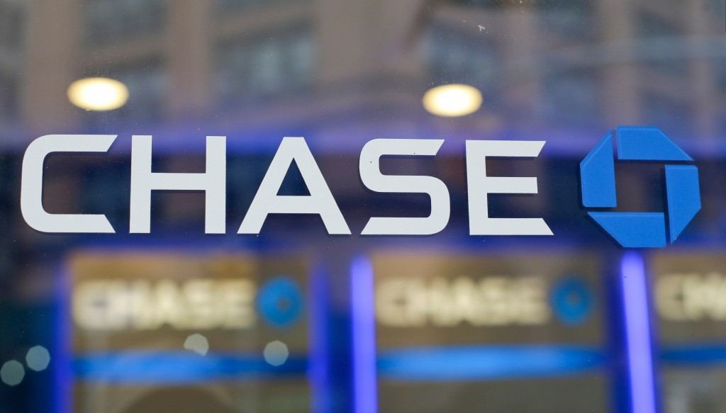 FILE - This Sept. 13, 2014, file photo, shows the Chase bank logo in New York. JPMorgan Chase says profits improved marginally in the third quarter, a...