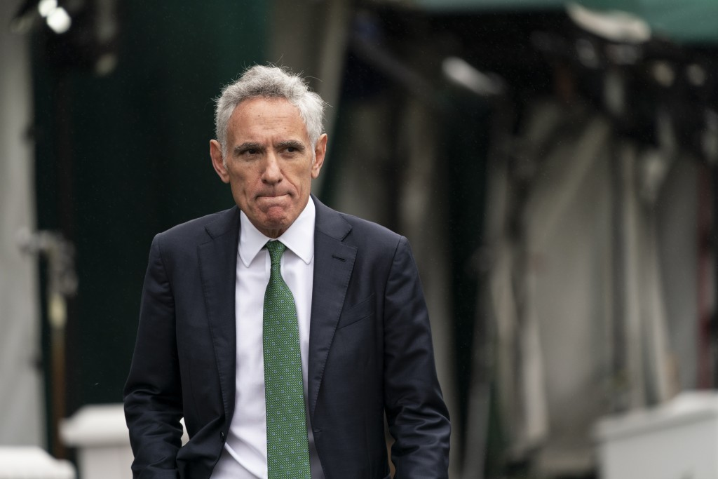 White House coronavirus adviser Dr. Scott Atlas departs after a television interview at the White House, Monday, Oct. 12, 2020, in Washington. (AP Pho...
