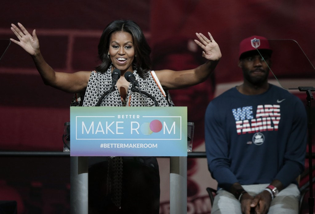 FILE - In this Oct. 21, 2015, file photo, former first lady Michelle Obama speaks at the University of Akron as NBA star LeBron James listens in rear,...