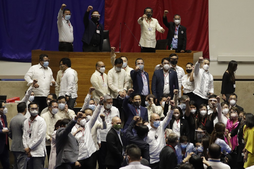 Supporters of new house speaker Lord Allan Velasco gestures after posing for pictures at the House of Representatives in Quezon city, Philippines on T...