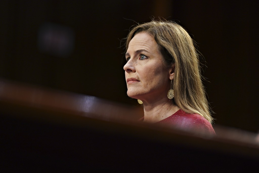 Supreme Court nominee Amy Coney Barrett listens during a confirmation hearing before the Senate Judiciary Committee, Tuesday, Oct. 13, 2020, on Capito...