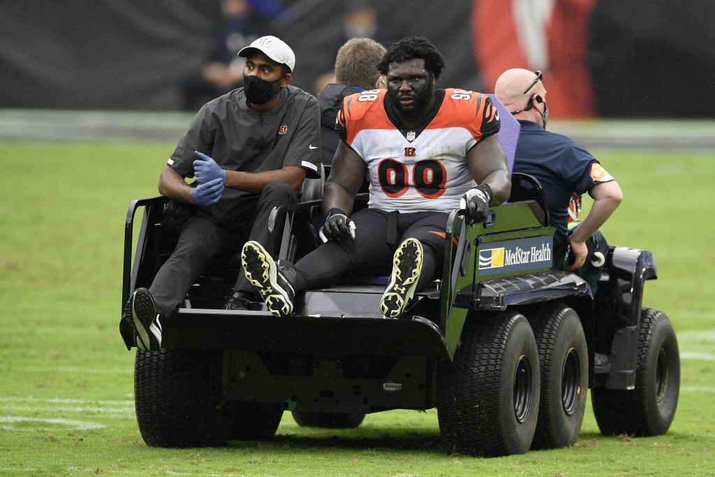 Cincinnati Bengals nose tackle D.J. Reader (98) is carted away after he was injured during the second half of an NFL football game against the Baltimo...