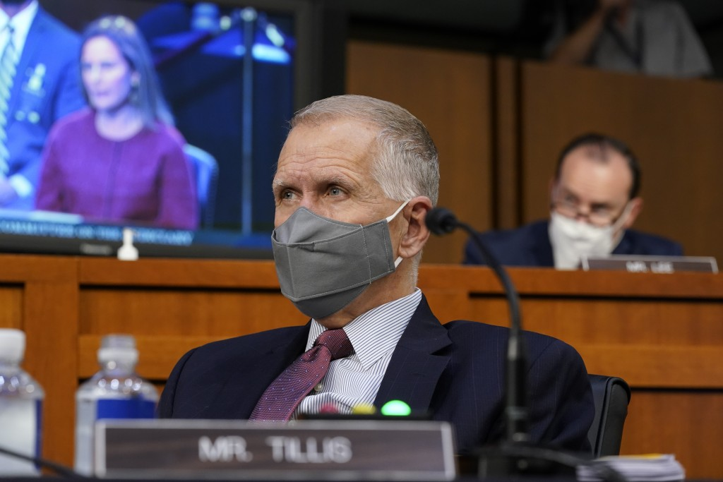 Sen. Thom Tillis, R-N.C., listens to Supreme Court nominee Amy Coney Barrett during her confirmation hearing before the Senate Judiciary Committee, Tu...