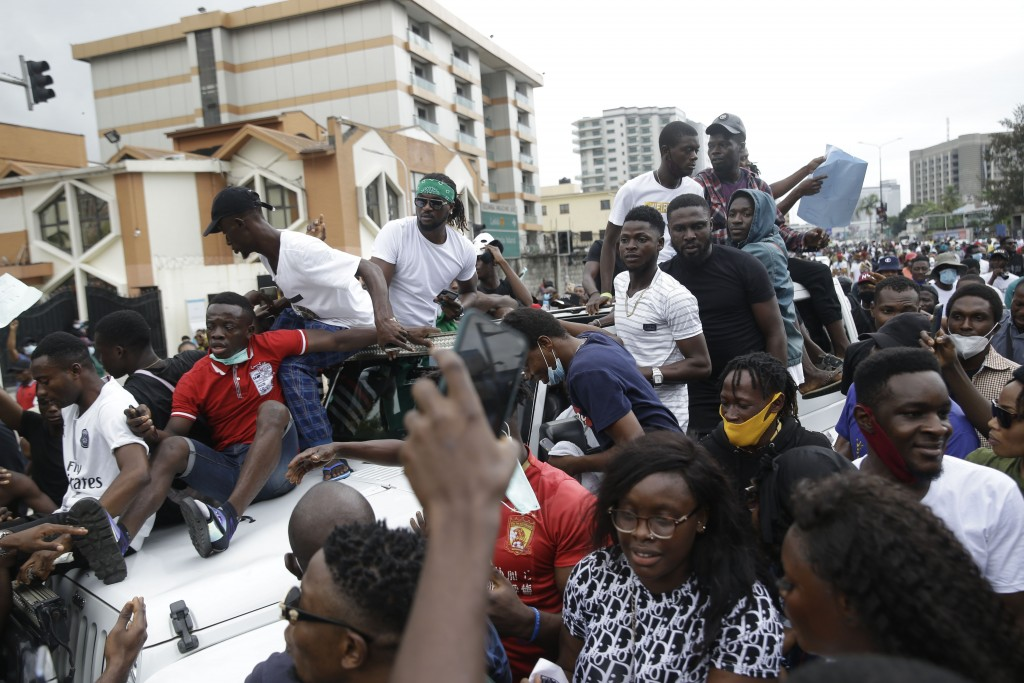 People demonstrate on the street to protest against police brutality in Lagos, Nigeria, Tuesday Oct. 13, 2020. Crowds protesting against police brutal...