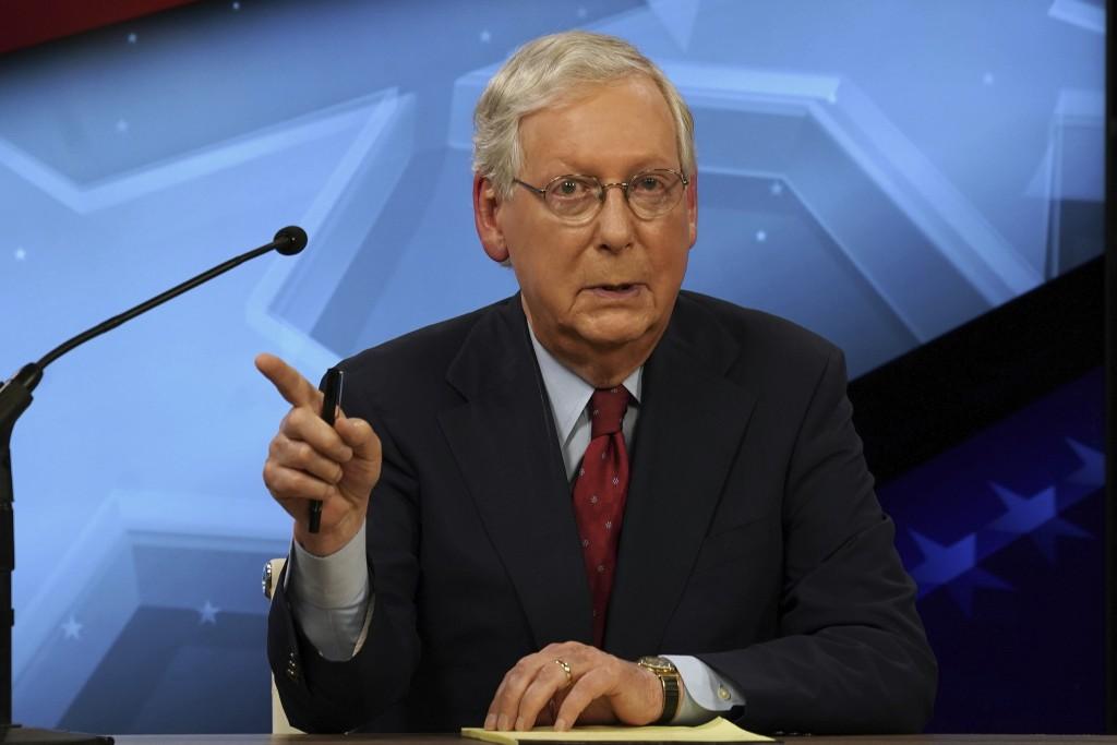Senate Majority Leader Mitch McConnell, R-Ky., debates with Democratic challenger Amy McGrath in Lexington, Ky., Monday, Oct. 12, 2020. (Michael Clubb...