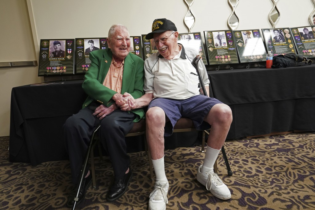 FILE - In this Aug. 28, 2018 file photo, surviving members of the famed WWII Army unit Merrill's Marauders, David Allan, of Rockhill SC, left, and Rob...