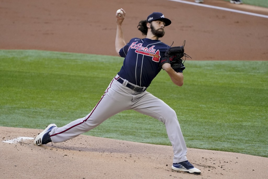 Atlanta Braves starting pitcher Ian Anderson throws against the Los Angeles Dodgers during the first inning in Game 2 of a baseball National League Ch...