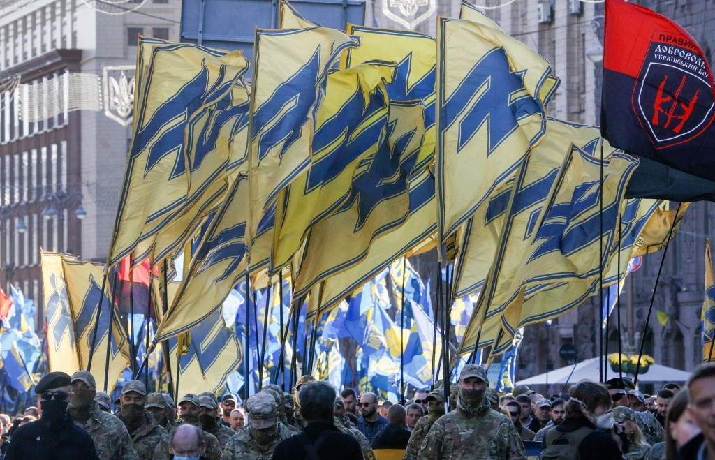 Soldiers of Ukrainian right-wing paramilitary Azov National Corps with their flags attend a rally marking Defender of Ukraine Day in centre Kyiv, Ukra...