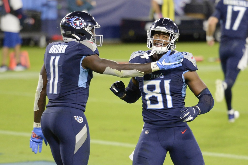 Tennessee Titans tight end Jonnu Smith (81) is congratulated by wide receiver A.J. Brown (11) after Smith caught a touchdown pass against the Buffalo ...