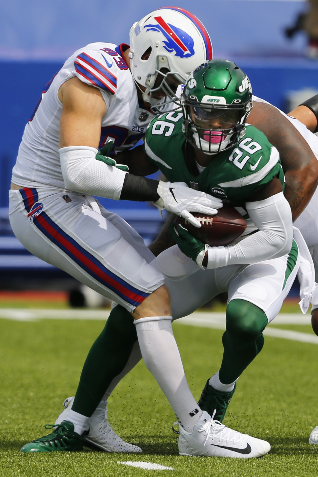 File-This Sept. 13, 2020 file photo shows Buffalo Bills Trent Murphy (93) tackling New York Jets Le'Veon Bell (26) during the first half of an NFL foo...