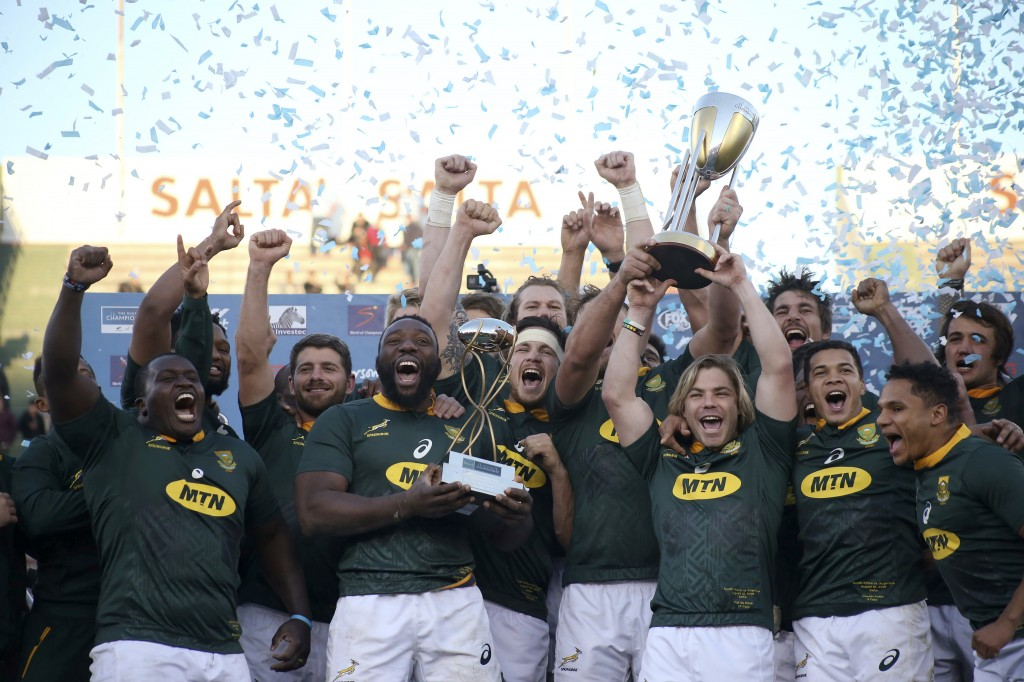 FILE - In this Aug. 10, 2019, file photo, South Africa trammates celebrate at the end of a rugby championship match against Argentina in Salta, Argent...