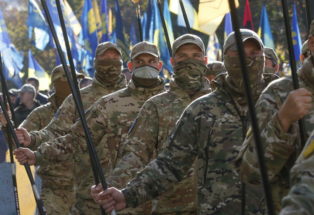 Ukrainian army veterans attend a rally marking Defender of Ukraine Day in centre Kyiv, Ukraine, Wednesday, Oct. 14, 2020. (AP Photo/Efrem Lukatsky)