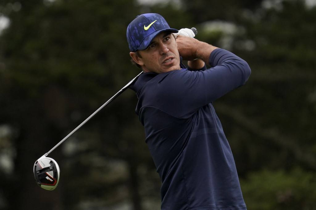 File-This Aug. 8, 2020, file photo shows Brooks Koepka watching his tee shot on the 14th hole during the third round of the PGA Championship golf tour...