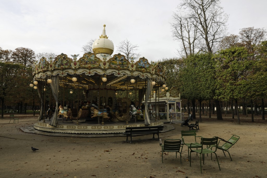 An empty carousel is pictured in the Tuileries gardens Wednesday, Oct.14, 2020 in Paris. French President Emmanuel Macron is giving a nationally telev...