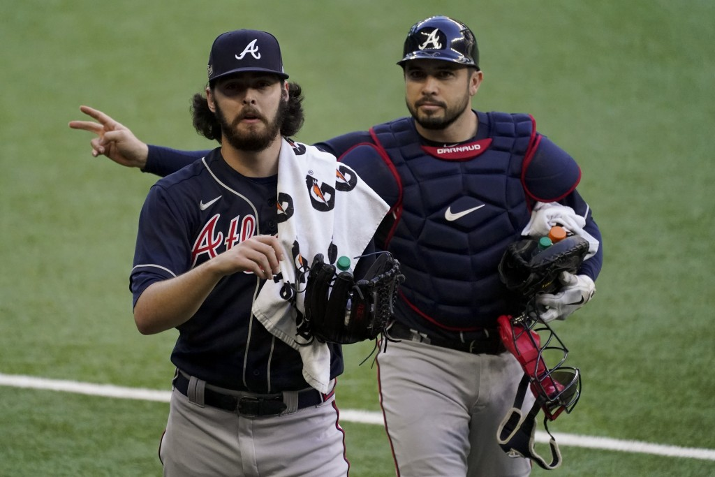 Atlanta Braves starting pitcher Ian Anderson and catcher Travis d'Arnaud walk to the dugout before Game 2 of a baseball National League Championship S...