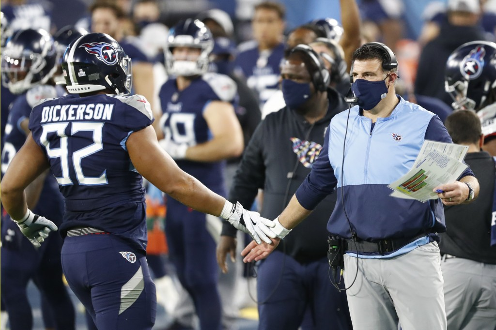 Tennessee Titans head coach Mike Vrabel slaps hands with defensive end Matt Dickerson (92) after a play against the Buffalo Bills in the first half of...