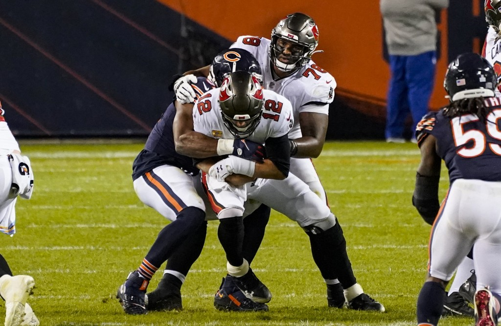Tampa Bay Buccaneers quarterback Tom Brady (12) is sacked by Chicago Bears outside linebacker Khalil Mack (52) during the second half of an NFL footba...
