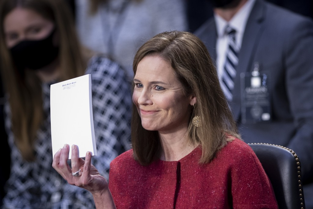 Supreme Court nominee Amy Coney Barrett holds up a notepad of paper during her confirmation hearing before the Senate Judiciary Committee on Capitol H...