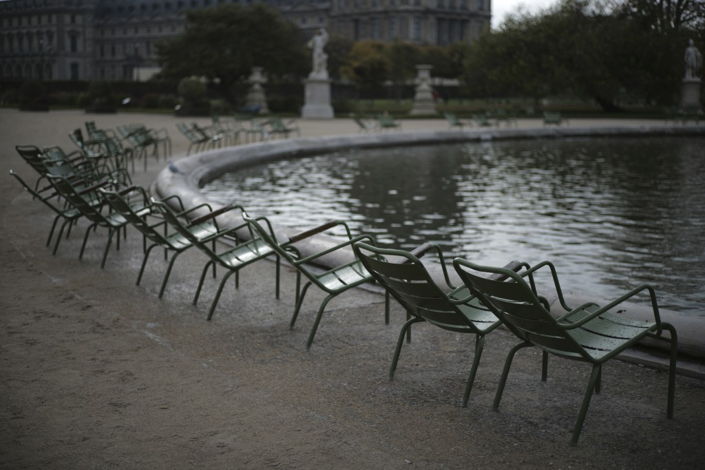 Empty chairs are pictured in the Tuileries gardens Wednesday, Oct.14, 2020 in Paris. French President Emmanuel Macron is giving a nationally televised...