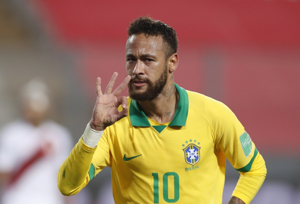 Brazil's Neymar celebrates scoring his third goal against Peru during a qualifying soccer match for the FIFA World Cup Qatar 2022 at the National Stad...