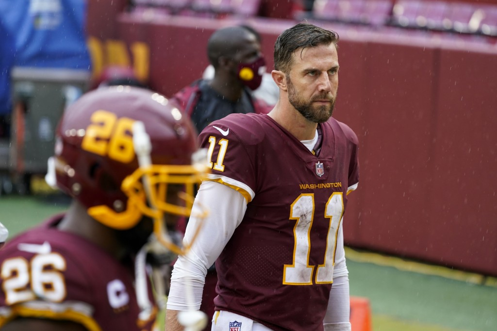 Washington Football Team's Alex Smith walks off the field after an NFL football game against the Los Angeles Rams Sunday, Oct. 11, 2020, in Landover, ...