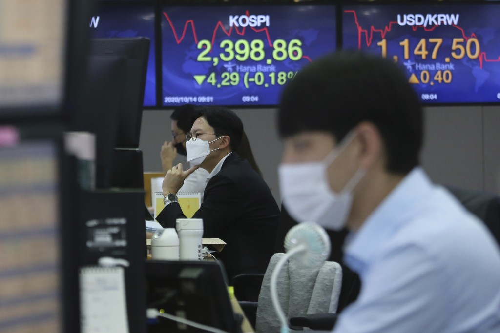 Currency traders watch monitors at the foreign exchange dealing room of the KEB Hana Bank headquarters in Seoul, South Korea, Wednesday, Oct. 14, 2020...